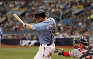 Jul 27, 2014; St. Petersburg, FL, USA; Tampa Bay Rays second baseman Ben Zobrist (18) singles during the fifth inning against the Boston Red Sox at Tropicana Field. Mandatory Credit: Kim Klement-USA TODAY Sports