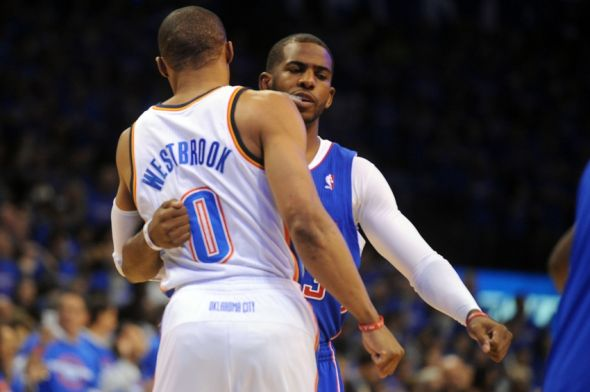 Oklahoma City Thunder guard Russell Westbrook (0) greets Los Angeles Clippers guard Chris Paul (3) prior to action in game one of the second round of the 2014 NBA Playoffs at Chesapeake Energy Arena. Mandatory Credit: Mark D. Smith-USA TODAY Sports