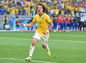 June 28, 2014; Belo Horizonte, BRAZIL; Brazil player David Luiz celebrates after converting on a penalty kick against Chile during the round of sixteen match in the 2014 World Cup at Estadio Mineirao. Mandatory Credit: Tim Groothuis/Witters Sport via USA TODAY Sports