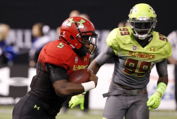 Jan 2, 2014; St. Petersburg, FL, USA; Team Highlight running back Leonard Fournette (5) runs with the ball during the first half as Team Nitro defensve end Chad Thomas (99) defends in the Under Armour All America football game at Tropicana Field. Mandatory Credit: Kim Klement-USA TODAY Sports
