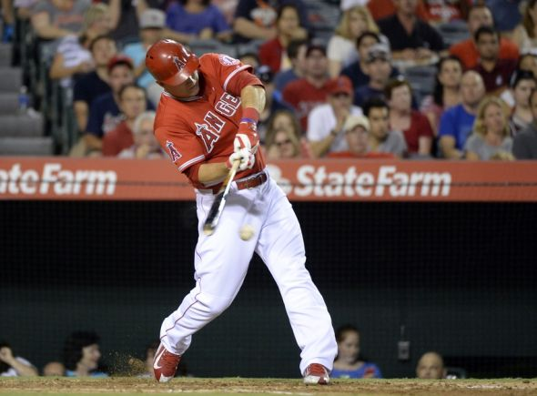 Jul 24, 2014; Anaheim, CA, USA; Los Angeles Angels center fielder Mike Trout (27) hits a single against the Detroit Tigers during the fourth inning at Angel Stadium of Anaheim. Mandatory Credit: Richard Mackson-USA TODAY Sports