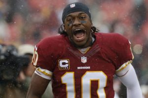 Dec 8, 2013; Landover, MD, USA; Washington Redskins quarterback Robert Griffin III (10) runs onto the field prior to the game against the Kansas City Chiefs at FedEx Field. Mandatory Credit: Geoff Burke-USA TODAY Sports
