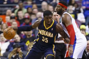 Mar 15, 2014; Auburn Hills, MI, USA; Indiana Pacers center Roy Hibbert (55) is defended by Detroit Pistons center Andre Drummond (0) in the first quarter at The Palace of Auburn Hills. Mandatory Credit: Rick Osentoski-USA TODAY Sports
