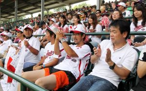 Aug 25, 2013; Williamsport, PA, USA; Japan fans cheer during the second inning against California (West) during the Little League World Series Championship game at Lamade Stadium. Mandatory Credit: Matthew O