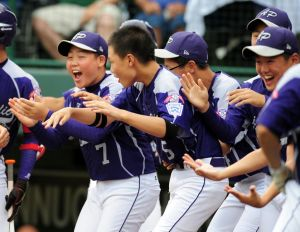 Aug 20, 2014; South Williamsport, PA, USA; Asia-Pacific infielder Jin Woo Jeon (7) and teammates celebrates after pitcher Hae Chan Choi (not pictured) hits a home run in the third inning at Lamade Stadium. Mandatory Credit: Evan Habeeb-USA TODAY Sports
