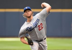 Aug 10, 2014; Milwaukee, WI, USA; Los Angeles Dodgers pitcher Clayton Kershaw (22) pitches in the first inning against the Milwaukee Brewers at Miller Park. Mandatory Credit: Benny Sieu-USA TODAY Sports