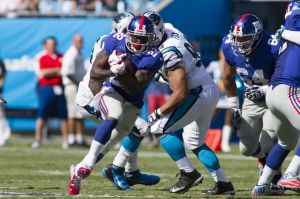 Sep 22, 2013; Charlotte, NC, USA; New York Giants running back David Wilson (22) runs the ball against the Carolina Panthers during the third quarter at Bank of America Stadium. The Panthers defeated the Giants 38-0. Mandatory Credit: Jeremy Brevard-USA TODAY Sports