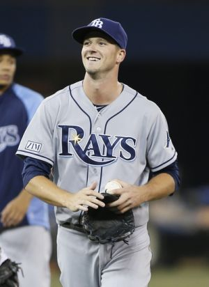 Aug 22, 2014; Toronto, Ontario, CAN; Tampa Bay Rays starting pitcher Drew Smyly (33) comes off the field after throwing a complete game shut out against the Toronto Blue Jays at Rogers Centre. Tampa Bay defeated Toronto 8-0. Mandatory Credit: John E. Sokolowski-USA TODAY Sports