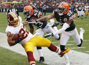 Dec 16, 2012; Cleveland, OH, USA; Washington Redskins running back Evan Royster (22) is forced out of bounds by Cleveland Browns strong safety T.J. Ward (43) and cornerback Joe Haden (23) during the second quarter at Cleveland Browns Stadium. Mandatory Credit: Ron Schwane-USA TODAY Sports
