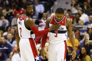 Feb 3, 2014; Washington, DC, USA; Washington Wizards point guard John Wall (2) celebrates with Wizards shooting guard Bradley Beal (3) against the Portland Trail Blazers in the fourth quarter at Verizon Center. The Wizards won 100-90. Mandatory Credit: Geoff Burke-USA TODAY Sports
