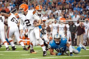 Aug 9, 2014; Detroit, MI, USA; Detroit Lions outside linebacker Kyle Van Noy (95) attempts to tackle Cleveland Browns quarterback Johnny Manziel (2) during the second quarter at Ford Field. Mandatory Credit: Tim Fuller-USA TODAY Sports