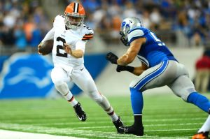 Aug 9, 2014; Detroit, MI, USA; Cleveland Browns quarterback Johnny Manziel (2) is forced out of bounds by Detroit Lions linebacker Travis Lewis (50) during the third quarter at Ford Field. Mandatory Credit: Andrew Weber-USA TODAY Sports