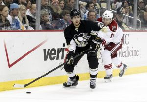 Mar 25, 2014; Pittsburgh, PA, USA; Pittsburgh Penguins defenseman Matt Niskanen (2) handles the puck as Phoenix Coyotes center Martin Hanzal (11) pressures during the first period at the CONSOL Energy Center. The Coyotes won 3-2. Mandatory Credit: Charles LeClaire-USA TODAY Sports
