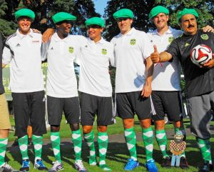 Aug 5, 2014; Portland, OR, USA; MLS players (left to right) Bobby Boswell, Bradley Wright-Phillips, Tim Cahill, Matt Besler, and Jon Kempin pose w. Fernando Fiore who won the Footgolf game during a player appearance in advance of the 2014 MLS All Star Game at Glendoveer Golf Course. Mandatory Credit: Susan Ragan-USA TODAY Sports