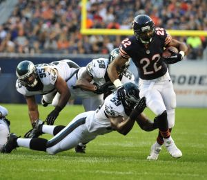 Aug 8, 2014; Chicago, IL, USA; Chicago Bears running back Matt Forte (22) runs and is tackled by Philadelphia Eagles inside linebacker DeMeco Ryans (59) in the first quarter during a preseason game at Soldier Field. Mandatory Credit: David Banks-USA TODAY Sports