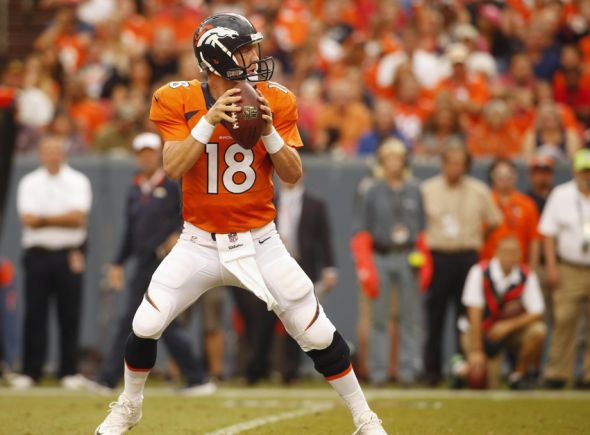 Aug 7, 2014; Denver, CO, USA; Denver Broncos quarterback Peyton Manning (18) looks to pass the ball during the first half against the Seattle Seahawks at Sports Authority Field at Mile High. Mandatory Credit: Chris Humphreys-USA TODAY Sports