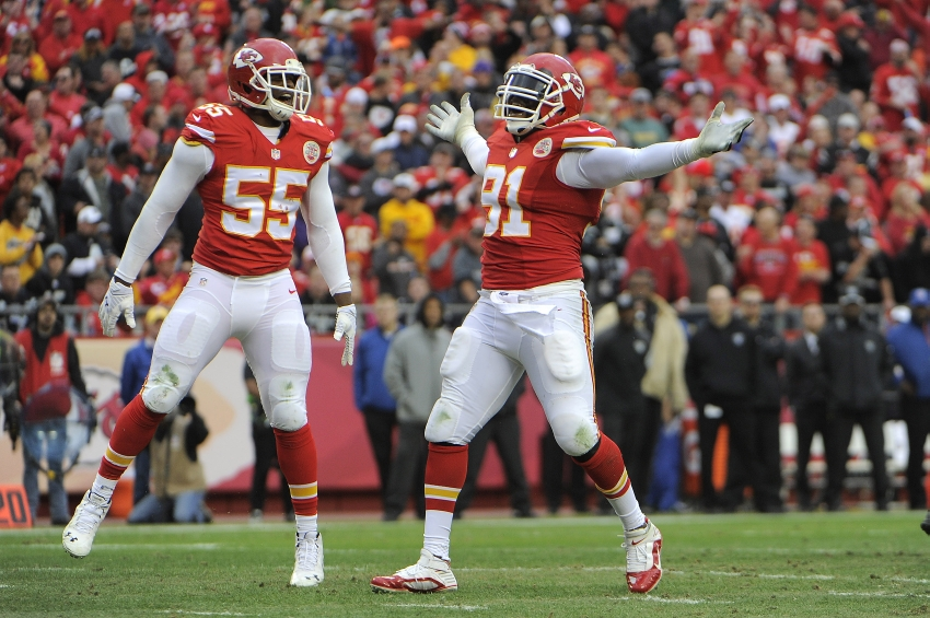 Dec 14, 2014; Kansas City, MO, USA; Kansas City Chiefs outside linebacker Tamba Hali (91) celebrates with linebacker Dee Ford (55) after a sack against the Oakland Raiders in the second half at Arrowhead Stadium. The Chiefs won 31-13. Mandatory Credit: John Rieger-USA TODAY Sports