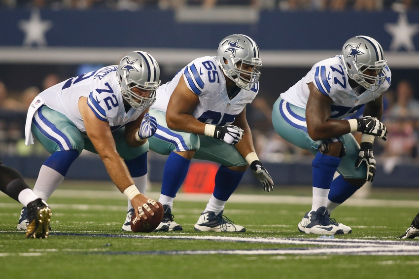 Sep 28, 2014; Arlington, TX, USA; Dallas Cowboys center Travis Frederick (72), guard Ronald Leary (65) and tackle Tyron Smith (77) on the line of scrimmage against the New Orleans Saints at AT&T Stadium. Dallas beat New Orleans 38-17. Mandatory Credit: Tim Heitman-USA TODAY Sports