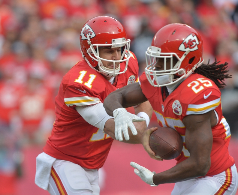 Kansas City Chiefs quarterback Alex Smith (11) hands off to running back Jamaal Charles (25) during the first half against the Oakland Raiders at Arrowhead Stadium. Mandatory Credit: Denny Medley-USA TODAY Sports