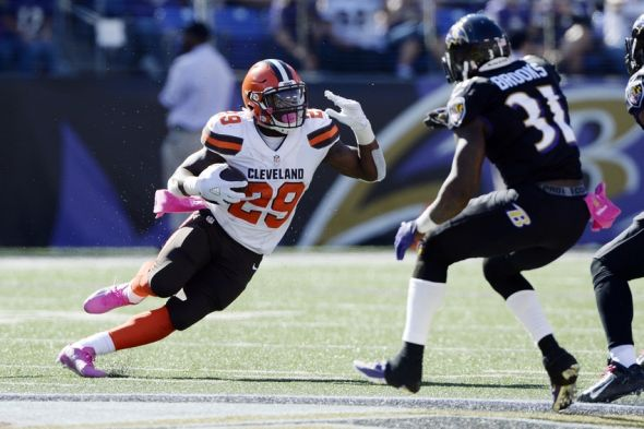 Oct 11, 2015; Baltimore, MD, USA; Cleveland Browns running back Duke Johnson (29) runs as Baltimore Ravens free safety Terrence Brooks (31) attempts to tackle during the second quarter at M&T Bank Stadium. Cleveland Browns defeated Baltimore Ravens 33-30 in over time. Mandatory Credit: Tommy Gilligan-USA TODAY Sports