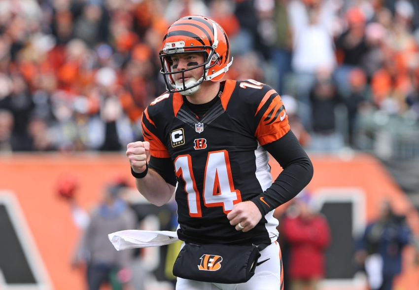Nov 29, 2015; Cincinnati, OH, USA; Cincinnati Bengals quarterback Andy Dalton (14) reacts to throwing a pass to wide receiver A.J. Green (not pictured) for a touchdown in the first half against the St. Louis Rams at Paul Brown Stadium. Mandatory Credit: Aaron Doster-USA TODAY Sports