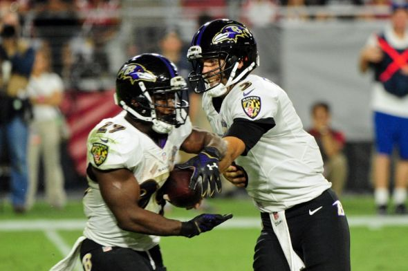 Oct 26, 2015; Glendale, AZ, USA; Baltimore Ravens quarterback Joe Flacco (5) hands off to running back Justin Forsett (29) during the second half against the Arizona Cardinals at University of Phoenix Stadium. Mandatory Credit: Matt Kartozian-USA TODAY Sports