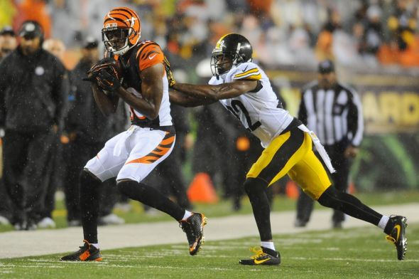 Jan 9, 2016; Cincinnati, OH, USA; Cincinnati Bengals wide receiver A.J. Green (18) makes a catch during the third quarter against Pittsburgh Steelers cornerback William Gay (22) in the AFC Wild Card playoff football game at Paul Brown Stadium. Mandatory Credit: Christopher Hanewinckel-USA TODAY Sports