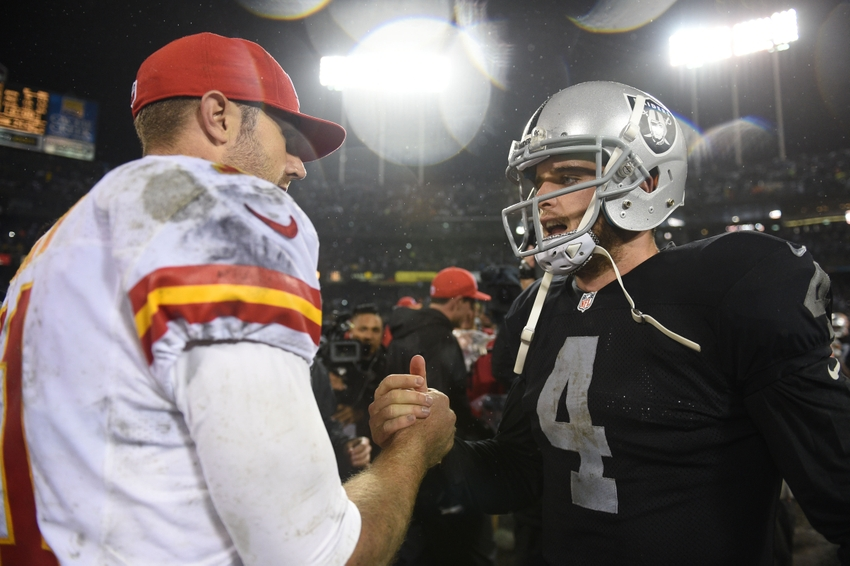 November 20, 2014; Oakland, CA, USA; Oakland Raiders quarterback Derek Carr (4) is congratulated by Kansas City Chiefs quarterback Alex Smith (11) after the game at O.co Coliseum. The Raiders defeated the Chiefs 24-20. Mandatory Credit: Kyle Terada-USA TODAY Sports