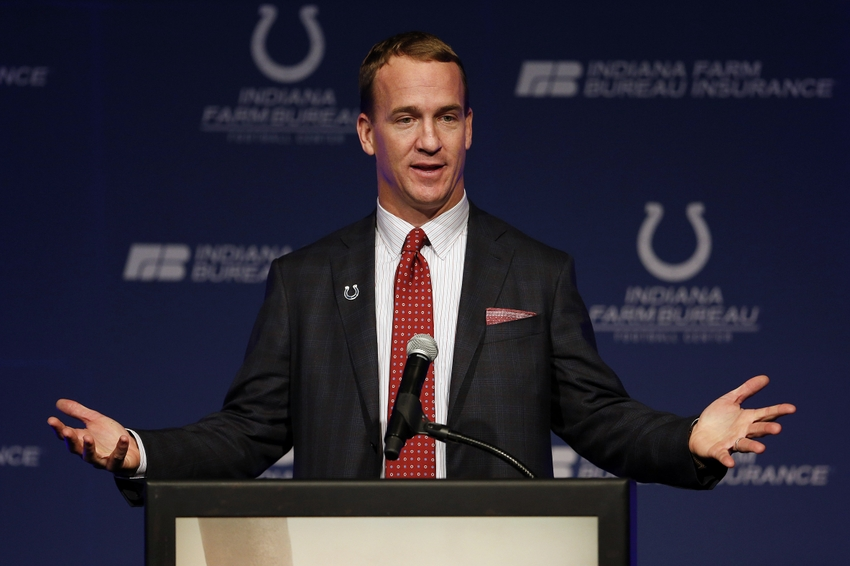 Mar 18, 2016; Indianapolis, IN, USA; Indianapolis Colts retired quarterback Peyton Manning speaks after he has his jersey is retired and a announcement is made that a statue will be built in his honor during in a press conference at Indiana Farm Bureau Football Center. Mandatory Credit: Brian Spurlock-USA TODAY Sports