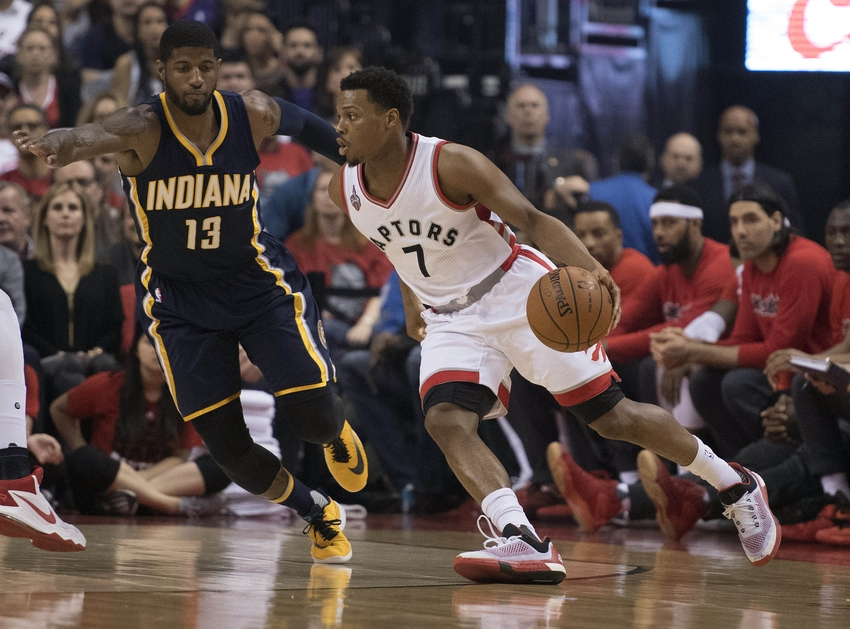 Apr 26, 2016; Toronto, Ontario, CAN; Toronto Raptors guard Kyle Lowry (7) looks to play a ball as Indiana Pacers forward Paul George (13) tries to defend during the first quarter in game five of the first round of the 2016 NBA Playoffs at Air Canada Centre. Mandatory Credit: Nick Turchiaro-USA TODAY Sports