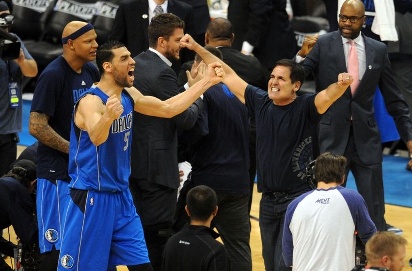 Apr 18, 2016; Oklahoma City, OK, USA; Dallas Mavericks center Salah Mejri (50) and Dallas Mavericks owner Mark Cuban celebrate after defeating the Oklahoma City Thunder 85-84 in game two of the first round of the NBA Playoffs at Chesapeake Energy Arena. Mandatory Credit: Mark D. Smith-USA TODAY Sports
