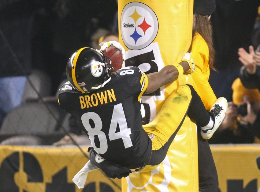 Dec 6, 2015; Pittsburgh, PA, USA; Pittsburgh Steelers wide receiver Antonio Brown (84) jumps onto the goal post padding after scoring on a seventy-one yard punt return for a touchdown against the Indianapolis Colts during the fourth quarter at Heinz Field. The Steelers won 45-10. Mandatory Credit: Charles LeClaire-USA TODAY Sports
