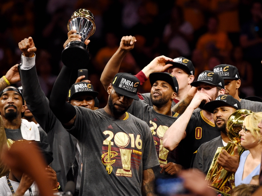 Jun 19, 2016; Oakland, CA, USA; Cleveland Cavaliers forward LeBron James (23) celebrates with the Bill Russell MVP Trophy after beating the Golden State Warriors in game seven of the NBA Finals at Oracle Arena. Mandatory Credit: Bob Donnan-USA TODAY Sports