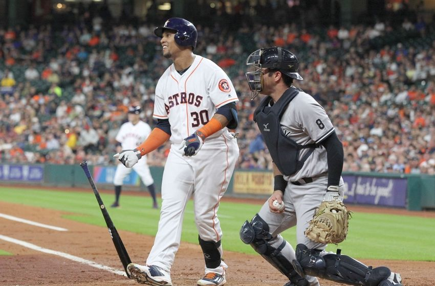 Jul 25, 2016; Houston, TX, USA; Houston Astros center fielder Carlos Gomez (30) strikes out to end the inning with a man in scoring position against the New York Yankees in the second inning at Minute Maid Park. Mandatory Credit: Thomas B. Shea-USA TODAY Sports
