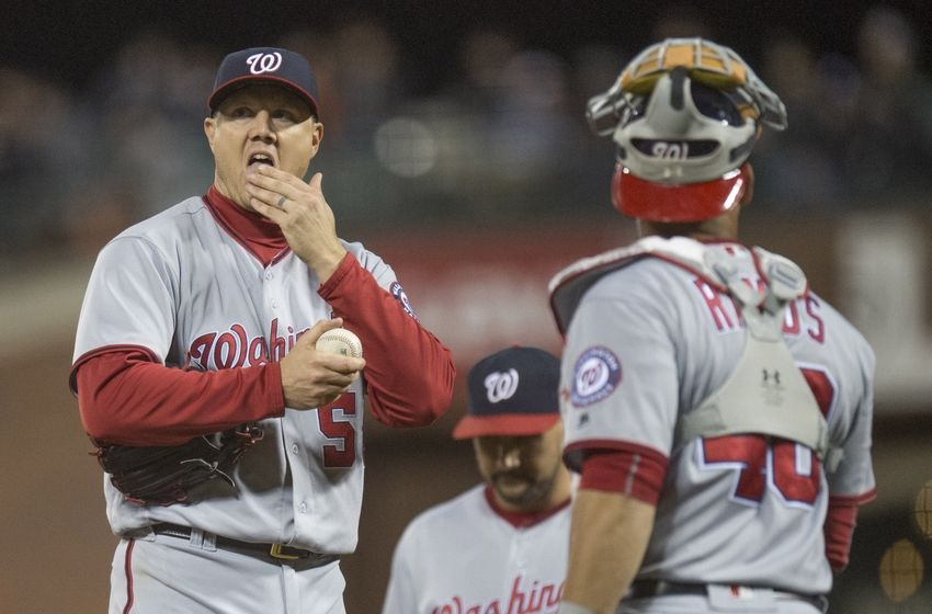 Jul 28, 2016; San Francisco, CA, USA; Washington Nationals relief pitcher Jonathan Papelbon (58) prepares to give the ball to Washington Nationals manager Dusty Baker (not pictured) while Washington Nationals catcher Wilson Ramos (40) looks on during the ninth inning against the San Francisco Giants at AT&T Park. Mandatory Credit: Kenny Karst-USA TODAY Sports