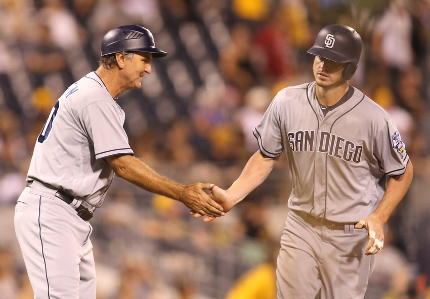 Aug 9, 2016; Pittsburgh, PA, USA; San Diego Padres third base coach Glenn Hoffman (30) greets first baseman Wil Myers (R) after Myers hit a solo home run against the Pittsburgh Pirates during the eighth inning at PNC Park. The Pirates won 6-4.Mandatory Credit: Charles LeClaire-USA TODAY Sports