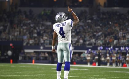 Aug 19, 2016; Arlington, TX, USA; Dallas Cowboys quarterback Dak Prescott (4) celebrates a touchdown in third quarter against the Miami Dolphins at AT&T Stadium. Dallas won 41-14. Mandatory Credit: Tim Heitman-USA TODAY Sports