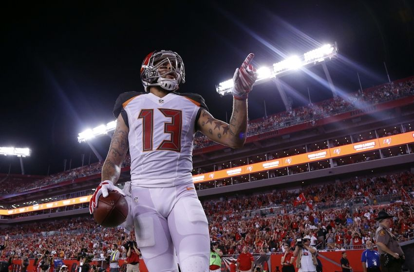 Aug 26, 2016; Tampa, FL, USA; Tampa Bay Buccaneers wide receiver Mike Evans (13) celebrates after he scored a touchdown against the Cleveland Browns during the first half at Raymond James Stadium. Mandatory Credit: Kim Klement-USA TODAY Sports