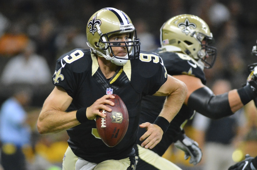 Sep 1, 2016; New Orleans, LA, USA; New Orleans Saints quarterback Drew Brees (9) scrambles away from pressure during the first quarter of the game against the Baltimore Ravens at the Mercedes-Benz Superdome. Mandatory Credit: Matt Bush-USA TODAY Sports