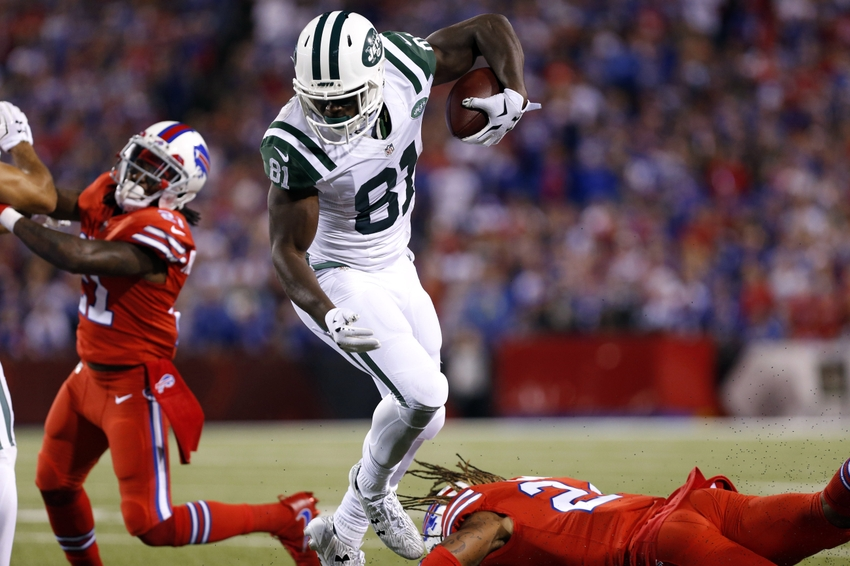 Sep 15, 2016; Orchard Park, NY, USA; New York Jets wide receiver Quincy Enunwa (81) runs after a catch and breaks a tackle by Buffalo Bills cornerback Stephon Gilmore (24) during the first quarter at New Era Field. Mandatory Credit: Kevin Hoffman-USA TODAY Sports