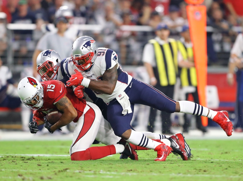 Sep 11, 2016; Glendale, AZ, USA; New England Patriots linebacker Jamie Collins (91) tackles Arizona Cardinals wide receiver Michael Floyd (15) at University of Phoenix Stadium. The Patriots defeated the Cardinals 23-21. Mandatory Credit: Mark J. Rebilas-USA TODAY Sports