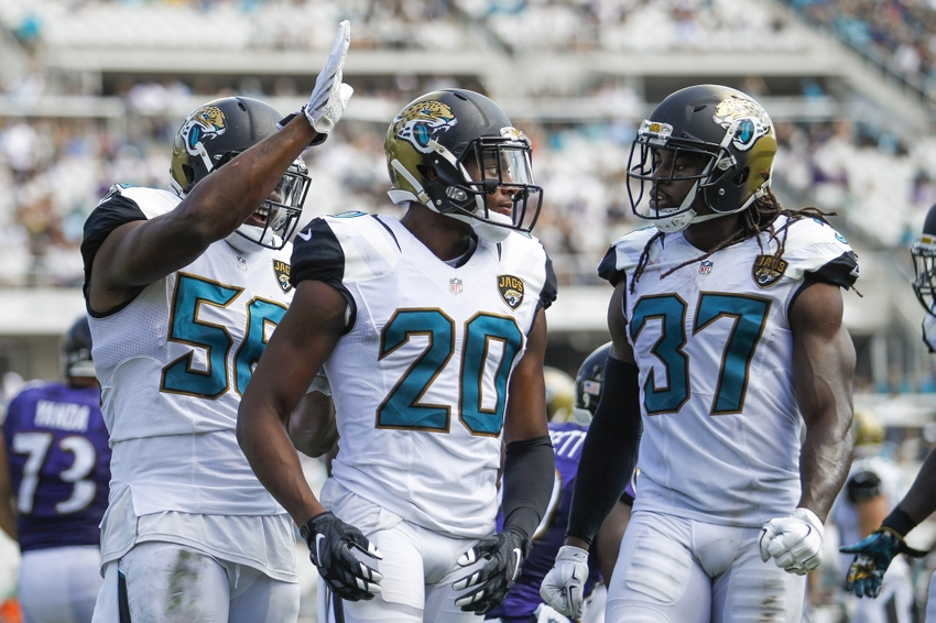 Sep 25, 2016; Jacksonville, FL, USA; Jacksonville Jaguars cornerback Jalen Ramsey (20) celebrates after a play with defensive end Dante Fowler (56) and strong safety Johnathan Cyprien (37) in the second quarter against the Baltimore Ravens at EverBank Field. Mandatory Credit: Logan Bowles-USA TODAY Sports