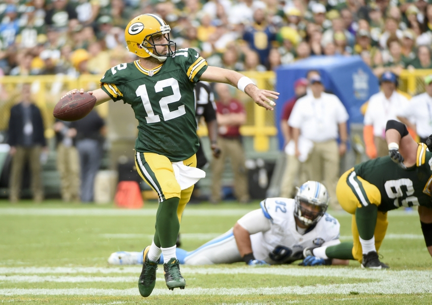 Sep 25, 2016; Green Bay, WI, USA; Green Bay Packers quarterback Aaron Rodgers (12) looks to pass in the third quarter during the game against the Detroit Lions at Lambeau Field. Mandatory Credit: Benny Sieu-USA TODAY Sports