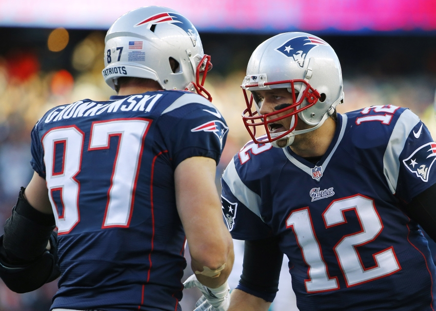 Dec 14, 2014; Foxborough, MA, USA; New England Patriots quarterback Tom Brady (12) celebrates with tight end Rob Gronkowski (87) after catching the ball to score a touchdown during the second half against the Miami Dolphins at Gillette Stadium. The Patriots won 41-13. Mandatory Credit: Winslow Townson-USA TODAY Sports