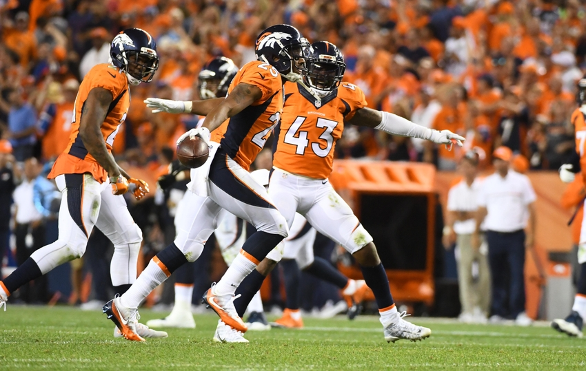 Sep 8, 2016; Denver, CO, USA; Denver Broncos cornerback Chris Harris (25) celebrates his interception with Denver Broncos cornerback Aqib Talib (21) and strong safety T.J. Ward (43) in the fourth quarter against the Carolina Panthers at Sports Authority Field at Mile High. Mandatory Credit: Ron Chenoy-USA TODAY Sports