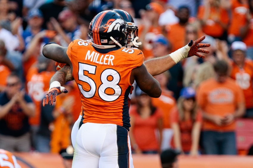 Sep 18, 2016; Denver, CO, USA; Denver Broncos outside linebacker Von Miller (58) celebrates with defensive end Derek Wolfe (95) after a play in the fourth quarter against the Indianapolis Colts at Sports Authority Field at Mile High. The Broncos won 34-20. Mandatory Credit: Isaiah J. Downing-USA TODAY Sports