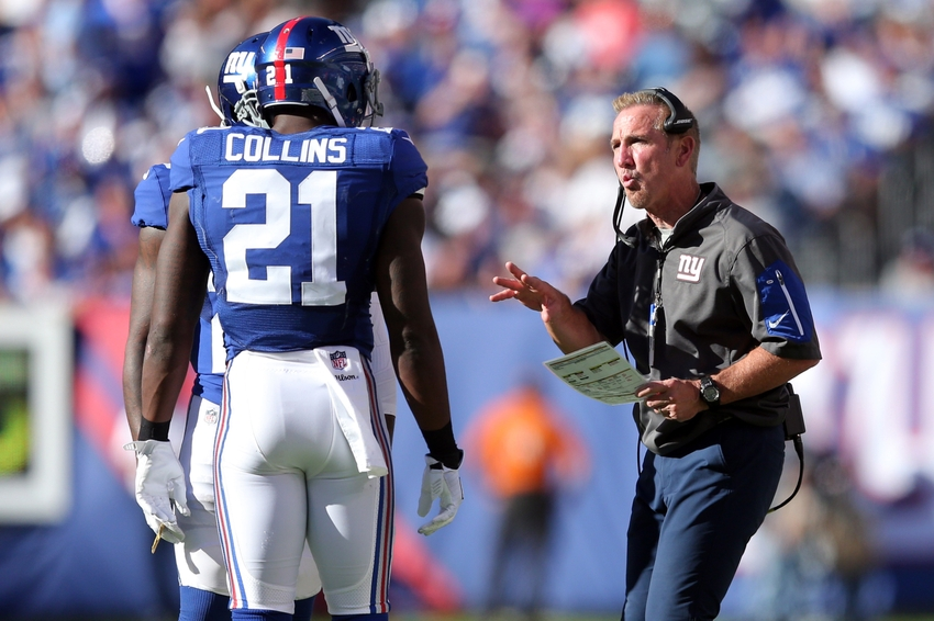 Sep 25, 2016; East Rutherford, NJ, USA; New York Giants defensive coordinator Steve Spagnuolo talks with New York Giants safety Landon Collins (21) and New York Giants corner back Janoris Jenkins (20) during the fourth quarter against the Washington Redskins at MetLife Stadium. Mandatory Credit: Brad Penner-USA TODAY Sports