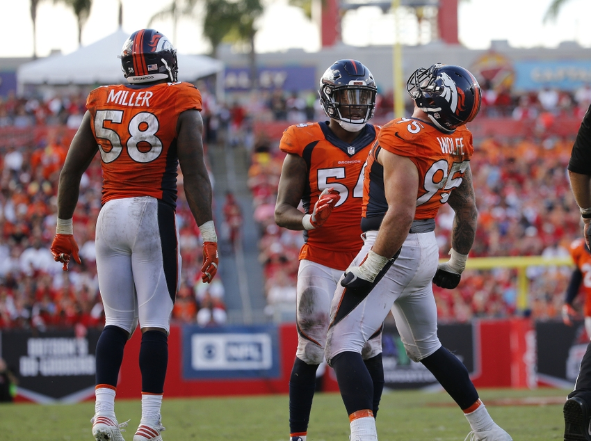 Oct 2, 2016; Tampa, FL, USA; Denver Broncos defensive end Derek Wolfe (95) celebrates with inside linebacker Brandon Marshall (54) and outside linebacker Von Miller (58) after he sacked Tampa Bay Buccaneers quarterback Jameis Winston (3) (not pictured) during the second half at Raymond James Stadium. Mandatory Credit: Kim Klement-USA TODAY Sports