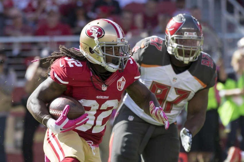 October 23, 2016; Santa Clara, CA, USA; San Francisco 49ers running back DuJuan Harris (32) runs against Tampa Bay Buccaneers defensive tackle Akeem Spence (97) during the first quarter at Levi's Stadium. Mandatory Credit: Kyle Terada-USA TODAY Sports