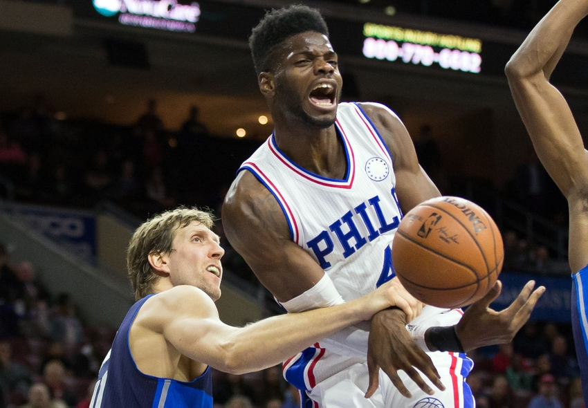 Nov 16, 2015; Philadelphia, PA, USA; Philadelphia 76ers forward Nerlens Noel (4) reacts as he is fouled by Dallas Mavericks forward Dirk Nowitzki (41) during the second half at Wells Fargo Center. The Mavericks won 92-86. Mandatory Credit: Bill Streicher-USA TODAY Sports